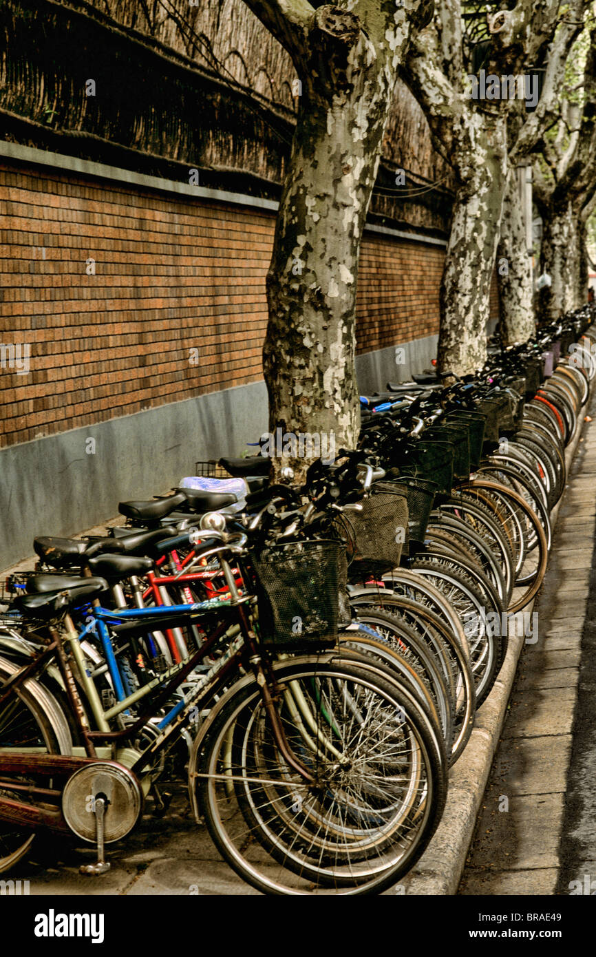Graphic portrayal of many children's bikes in Shanghai China  - Stock Image