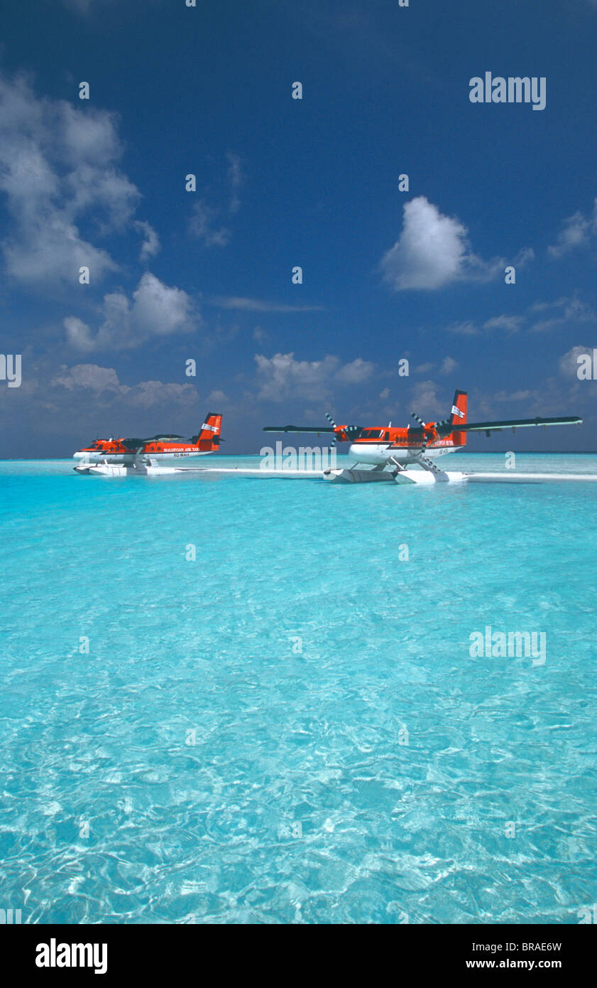 Maldivian air taxi seaplanes parked on sandbank, Maldives, Indian Ocean, Asia - Stock Image