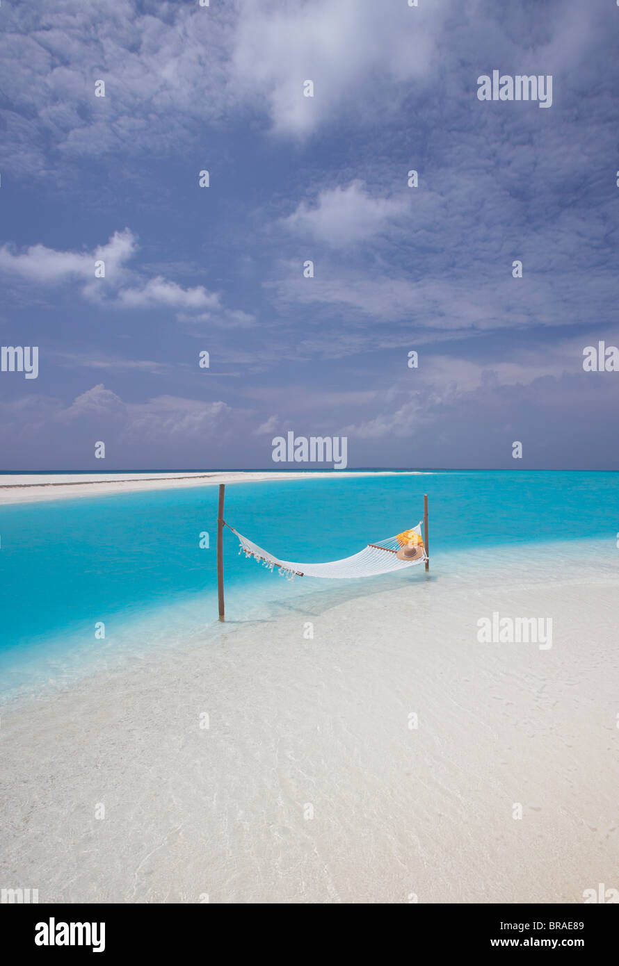 Hammock on the edge of beach, Maldives, Indian Ocean, Asia - Stock Image