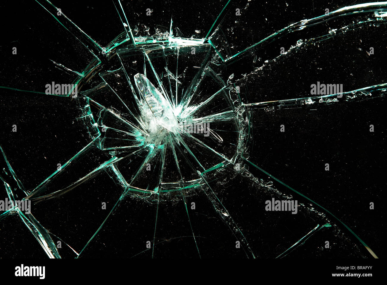 broken glass on a black background - Stock Image