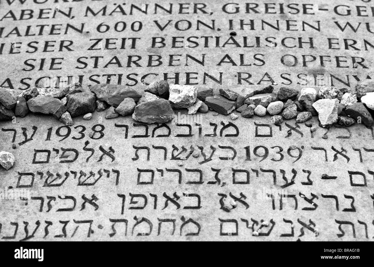 Part of a memorial in German and Hebrew at the Buchenwald concentration camp in Germany, near Weimar in the state - Stock Image