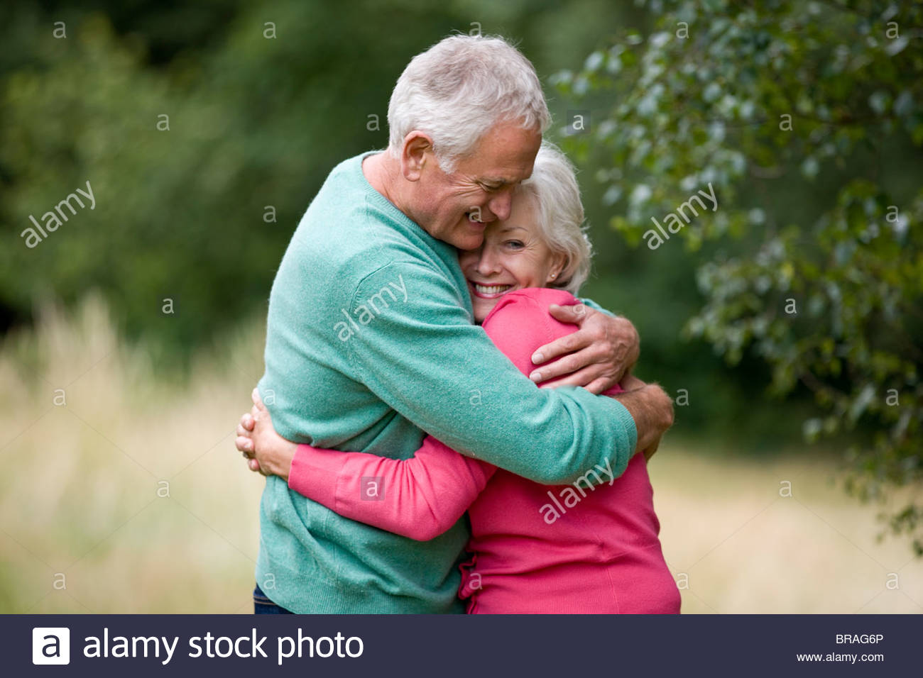 Portrait of a senior couple hugging, outdoors Stock Photo