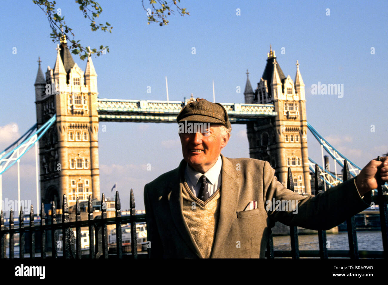 Stately Englishman in front of the famous Tower Bridge in London England - Stock Image