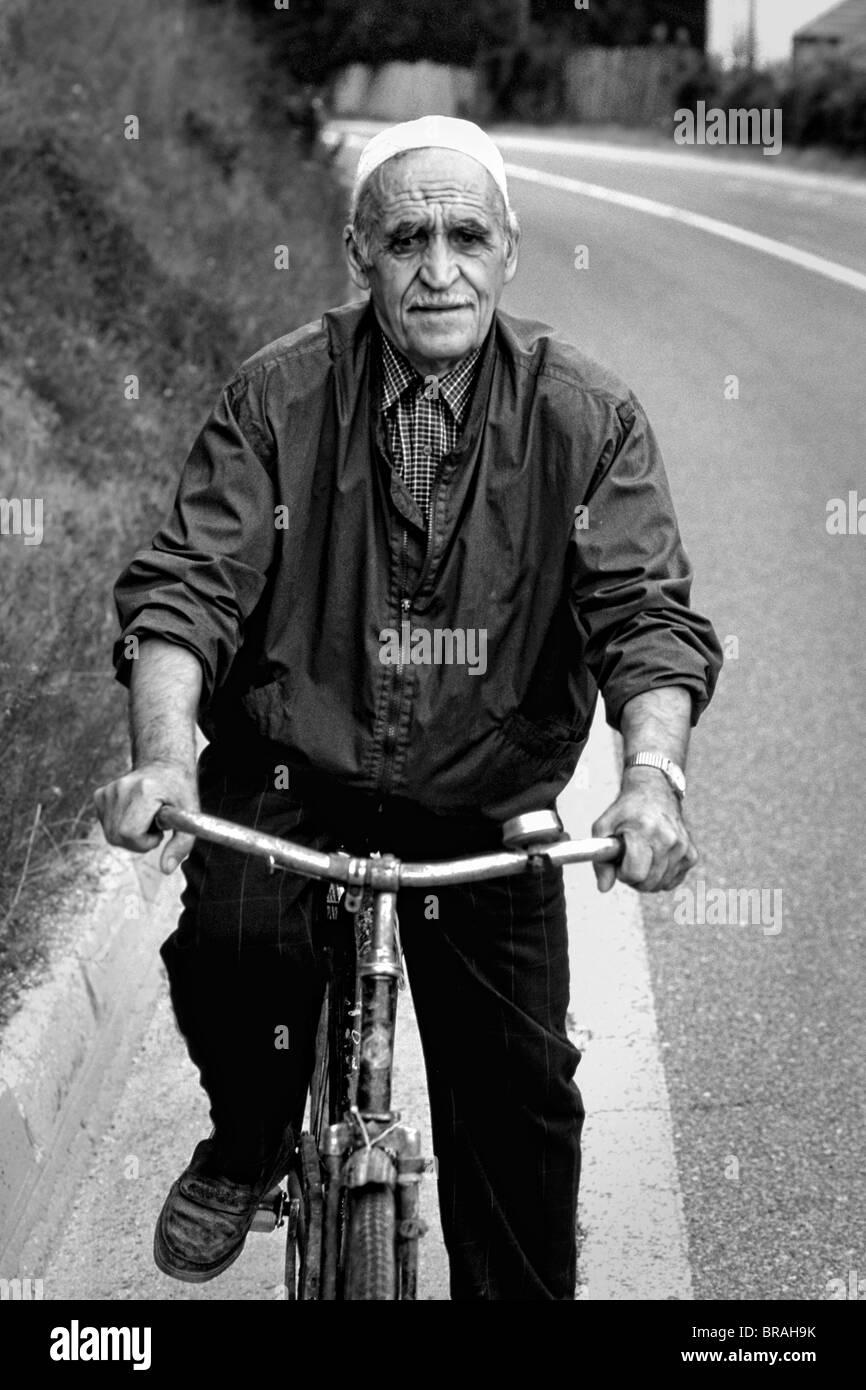 Man on bicycle in Albania near Tirana - Stock Image