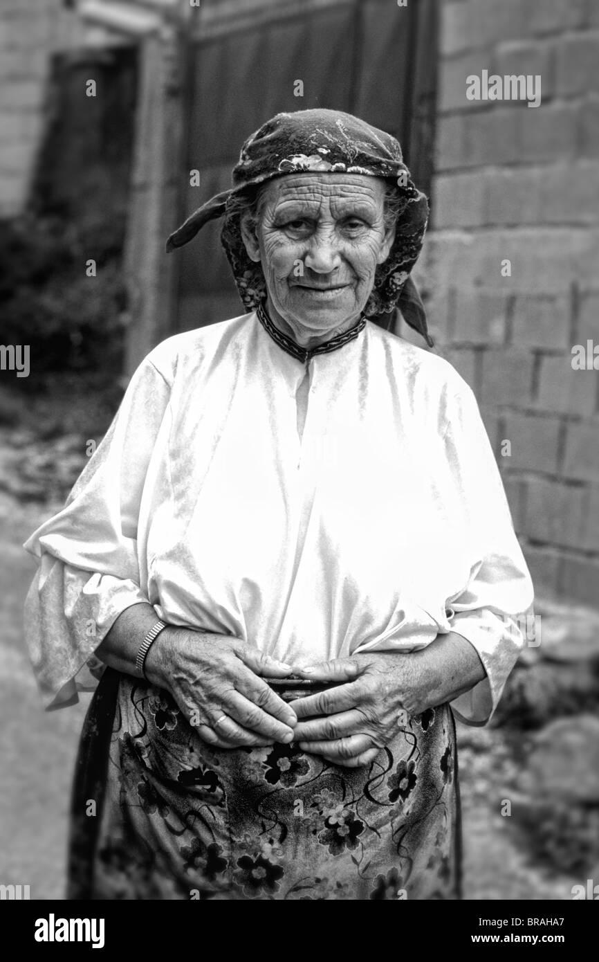 Woman in colorful clothes in Albania near Tirana - Stock Image