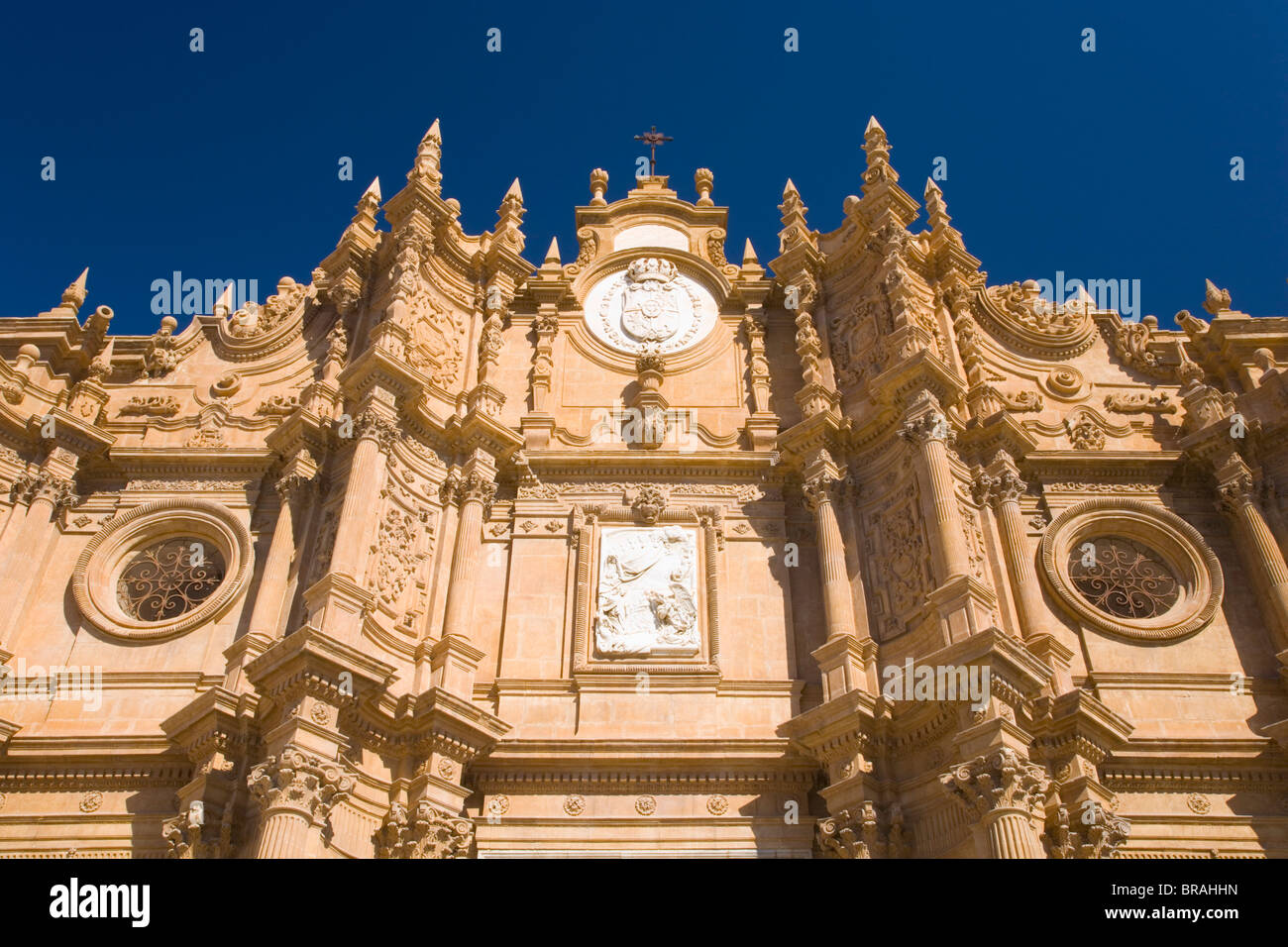 View from below of richly decorated facade of the cathedral, Guadix, Granada, Andalucia (Andalusia), Spain, Europe - Stock Image