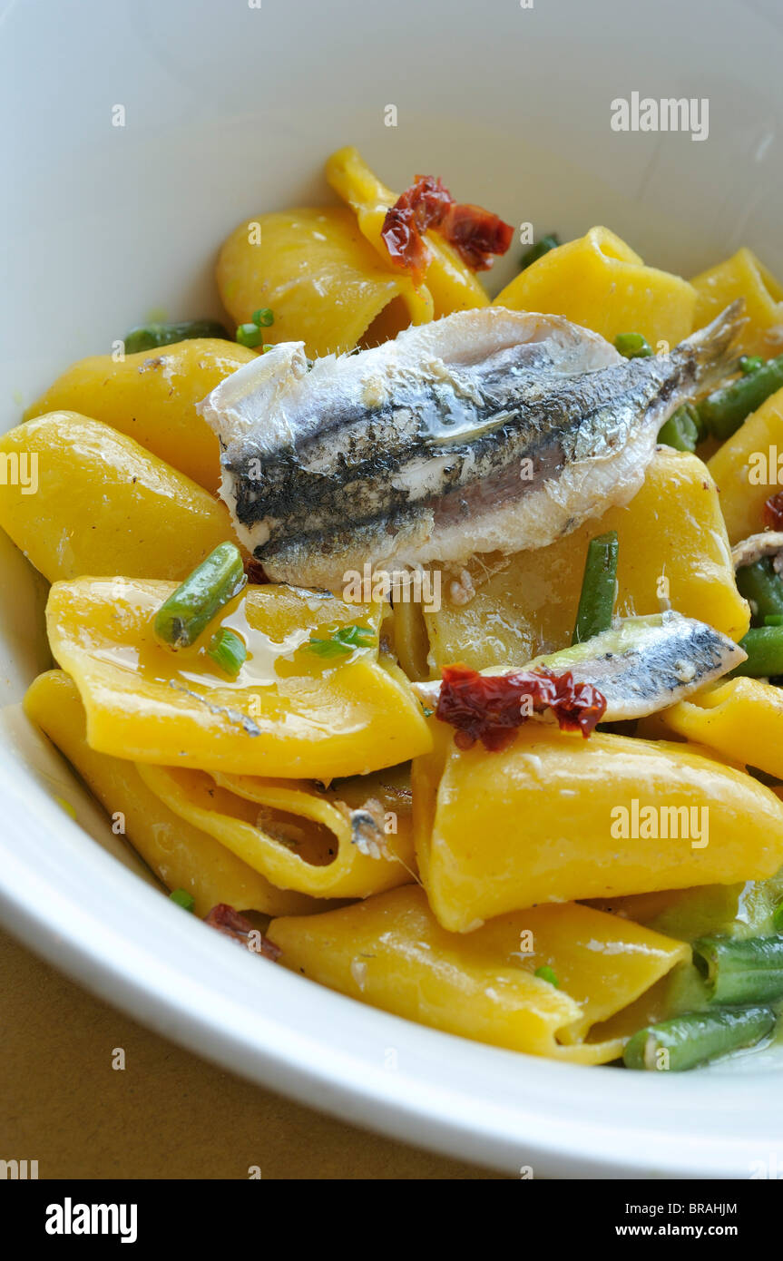 Trieste. Italy. Fresh Paccheri (Pasta) with green beans & anchovies at the Audace Café, Piazza Unità - Stock Image