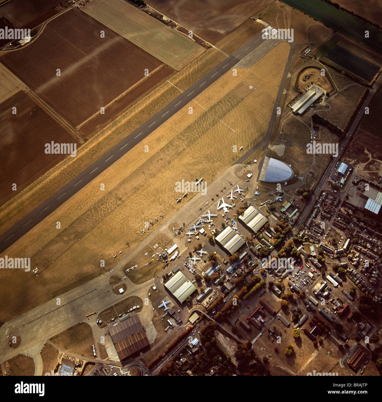 Aerial view of Duxford Aerodrome, now Imperial War Museum Duxford and the American Air Museum, Cambridgeshire, England, - Stock Image