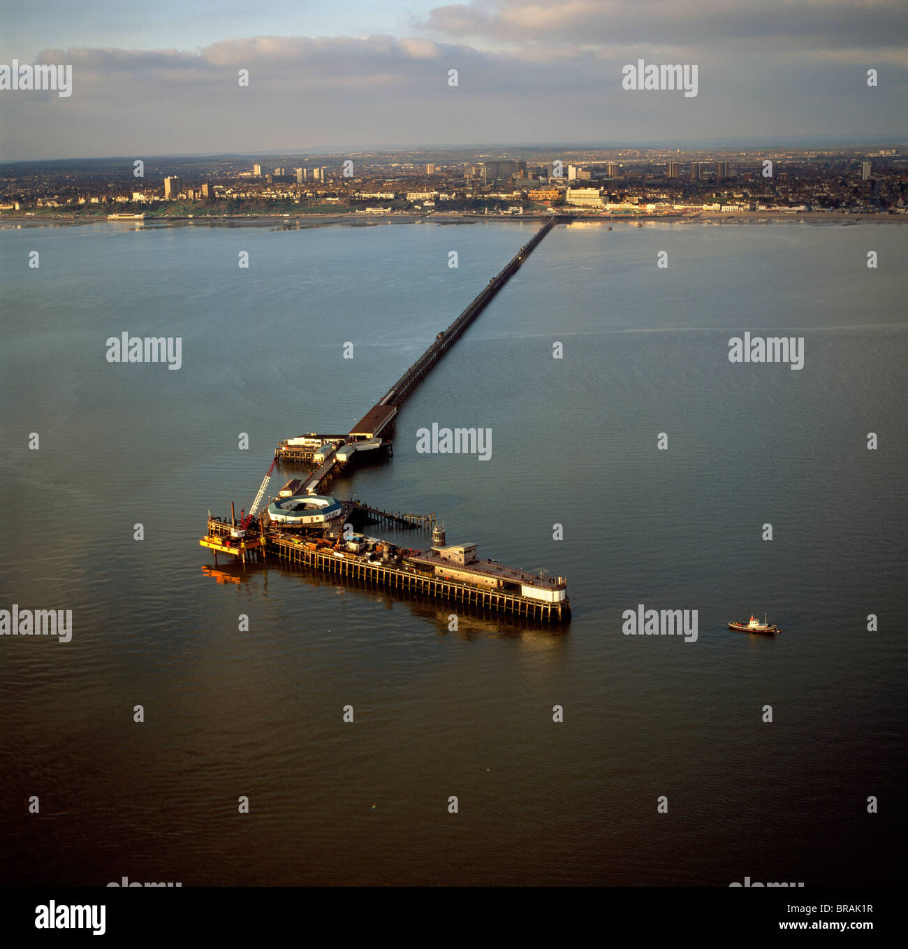 Aerial image of Southend Pier, the longest pleasure pier in the world, and estuary of the River Thames, Southend - Stock Image