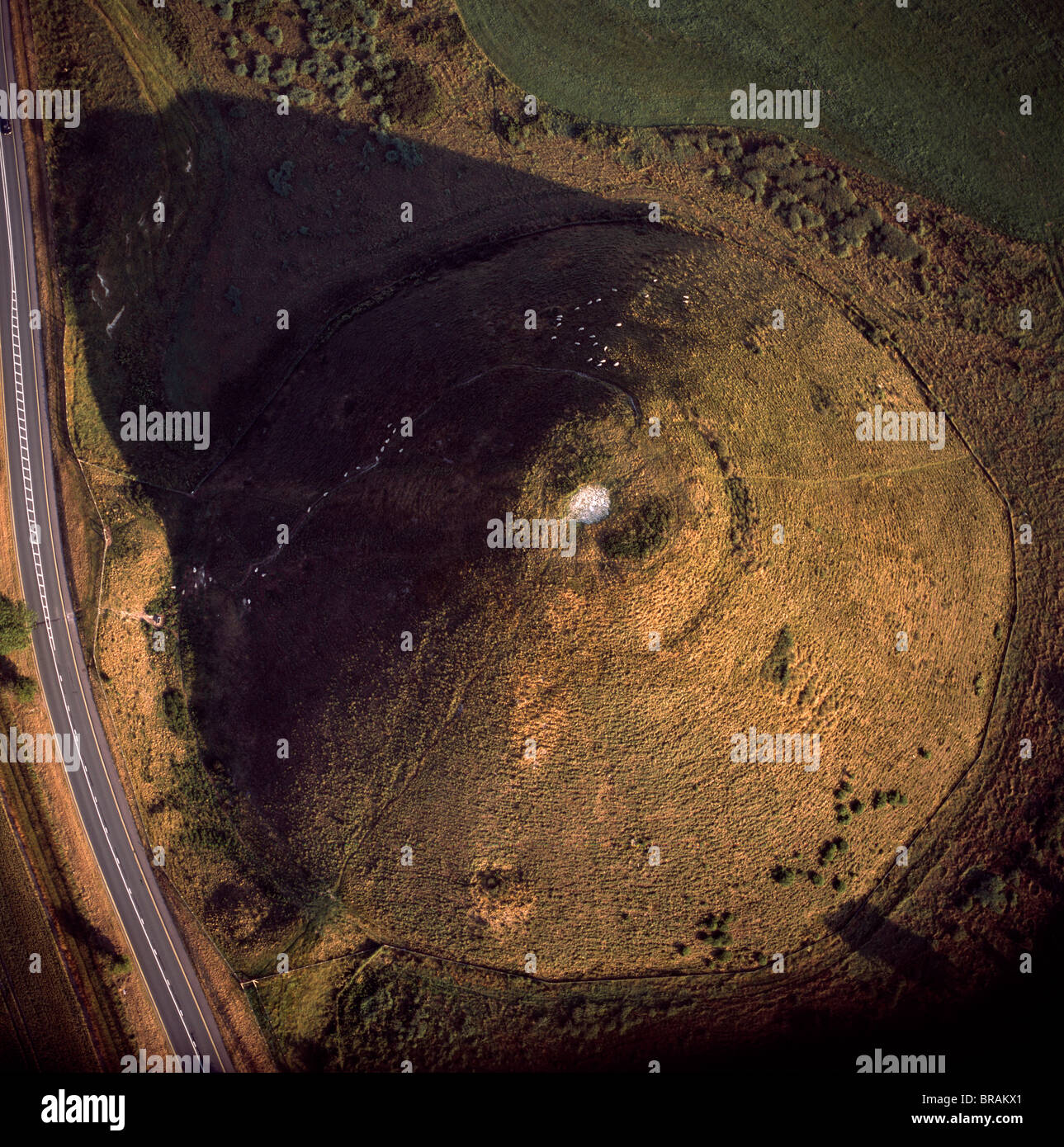 Aerial image of Silbury Hill, a prehistoric human-made chalk and clay mound near Avebury, UNESCO, Wiltshire, England, - Stock Image
