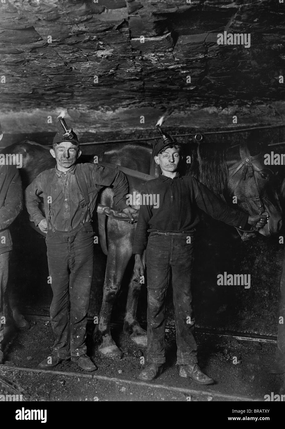 Vintage photo c1908 by Lewis Wickes Hine of boys working in a coal mine in West Virginia, USA. - Stock Image