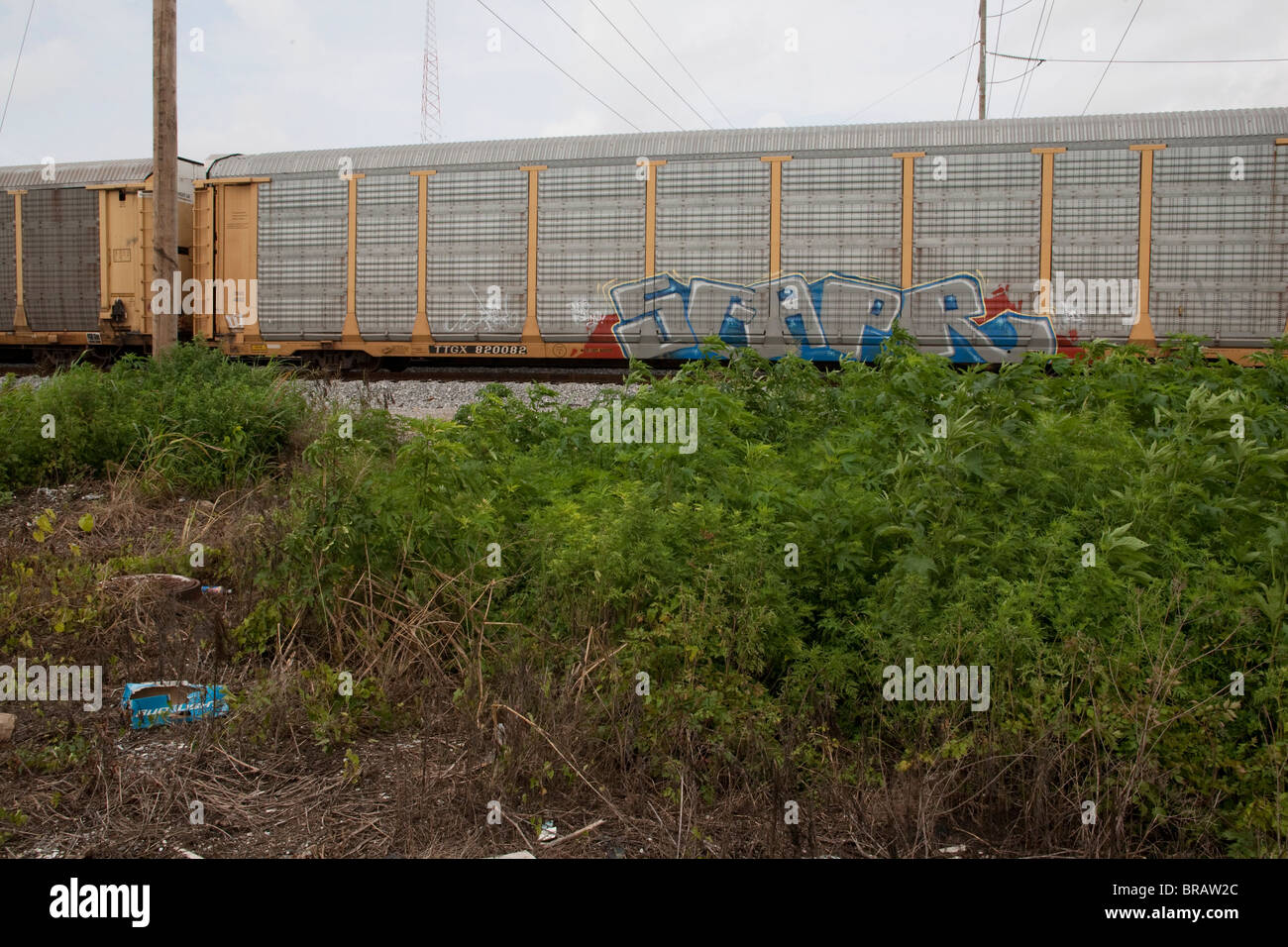 A rail car on the Public Belt railroad system in New Orleans is marked by graffiti. - Stock Image