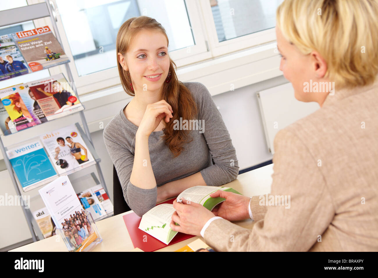 Young girl at career counseling office - Stock Image