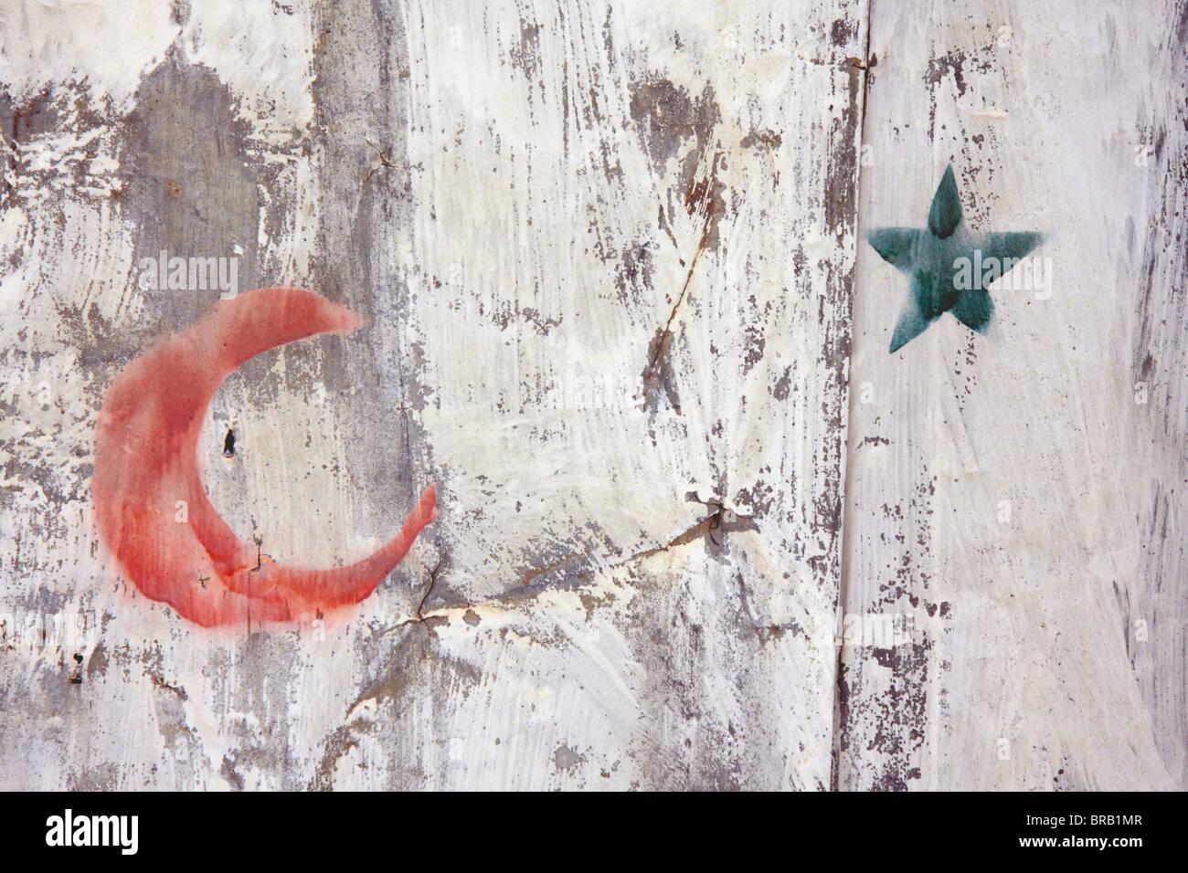 Muslim star and crescent spray-painted with a stencil on a metal ...