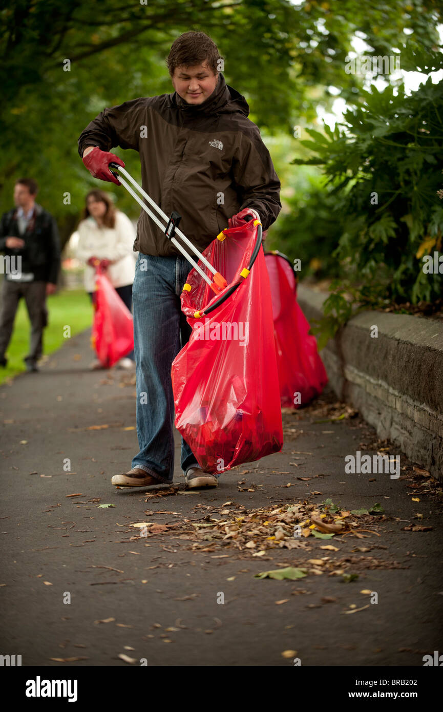 Adult volunteers collecting litter in a park, Aberystwyth Wales UK - Stock Image