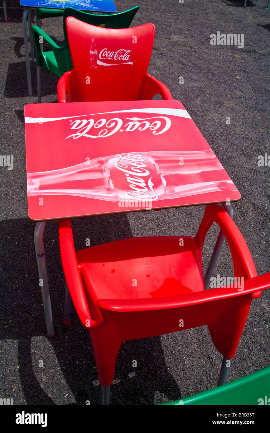 bright red plastic coca cola logo table and chairs at restaurant on