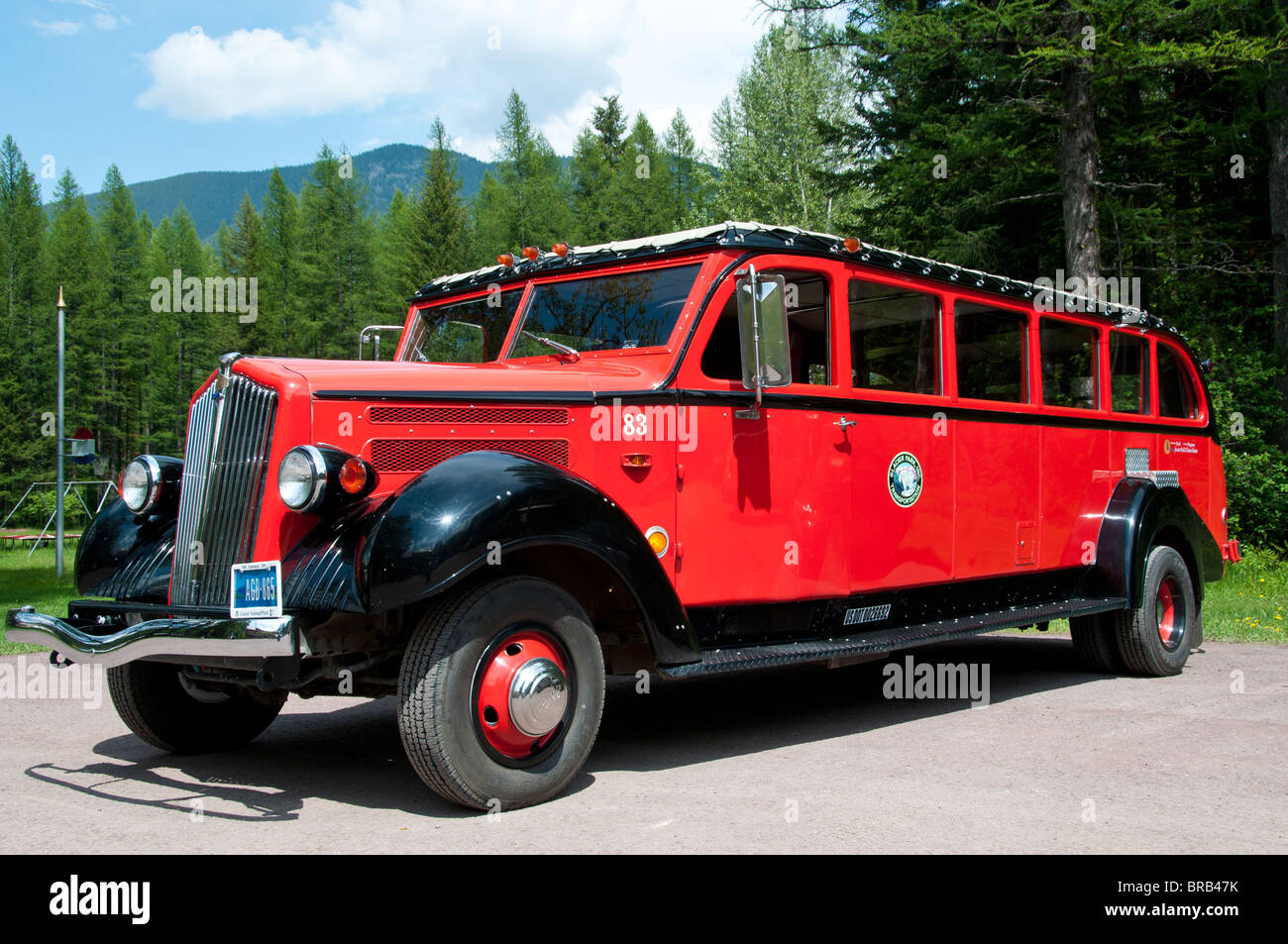 Red bus outside Izaak Walton Inn, Essex, Montana. - Stock Image