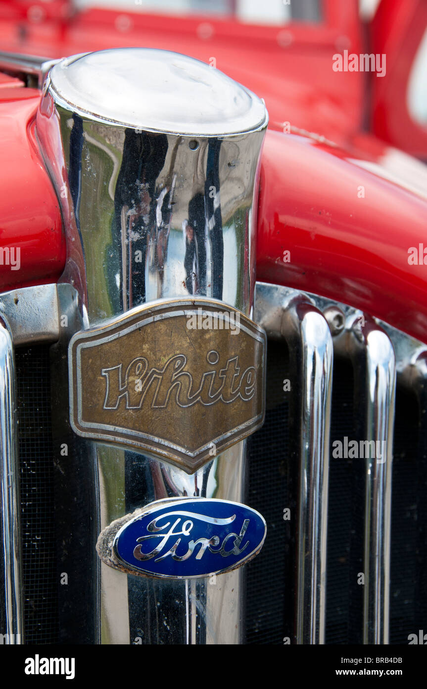 White and Ford emblems, red bus, Glacier National Park, Montana. - Stock Image