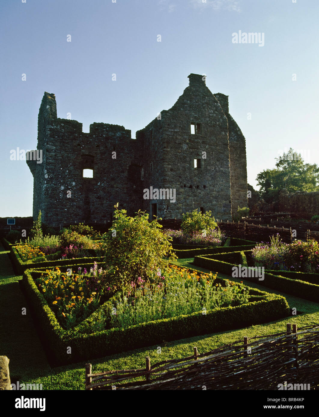 Old Castle Ruins,With Immaculate Formal Garden In Foreground - Stock Image