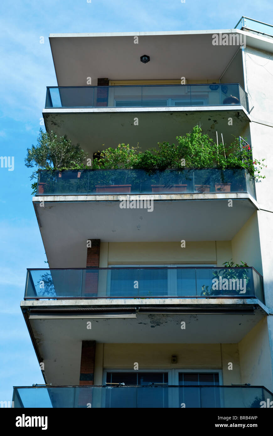 Italian apartments, Rome, Italy View from below underneath. Close up Italy apartment flat home balcony garden updated - Stock Image