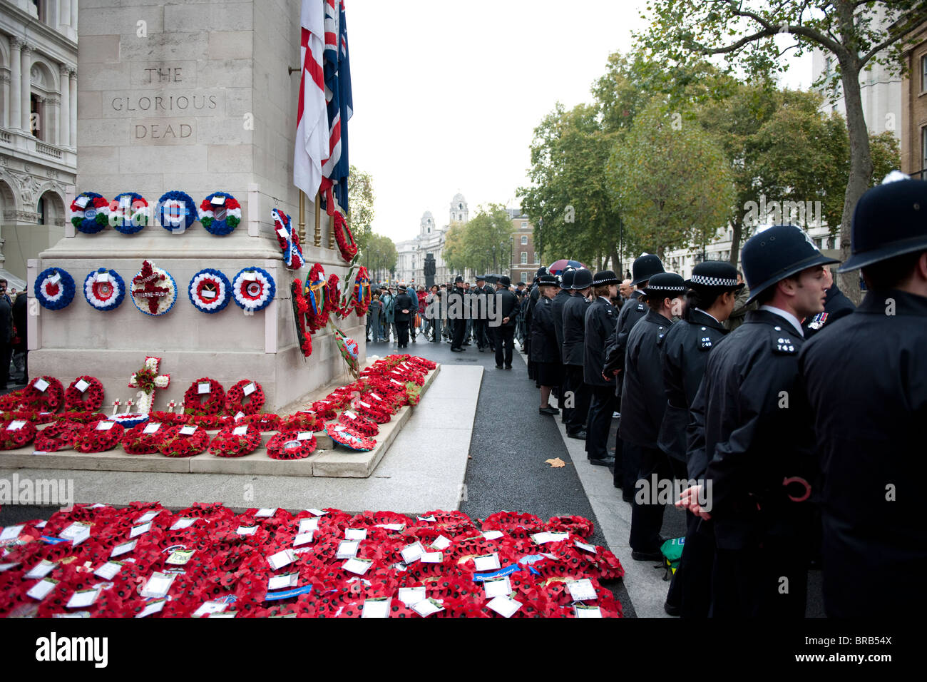 Poppies and wreaths spread around The Cenotaph in Whitehall, London, for the annual Remembrance Day Parade. - Stock Image