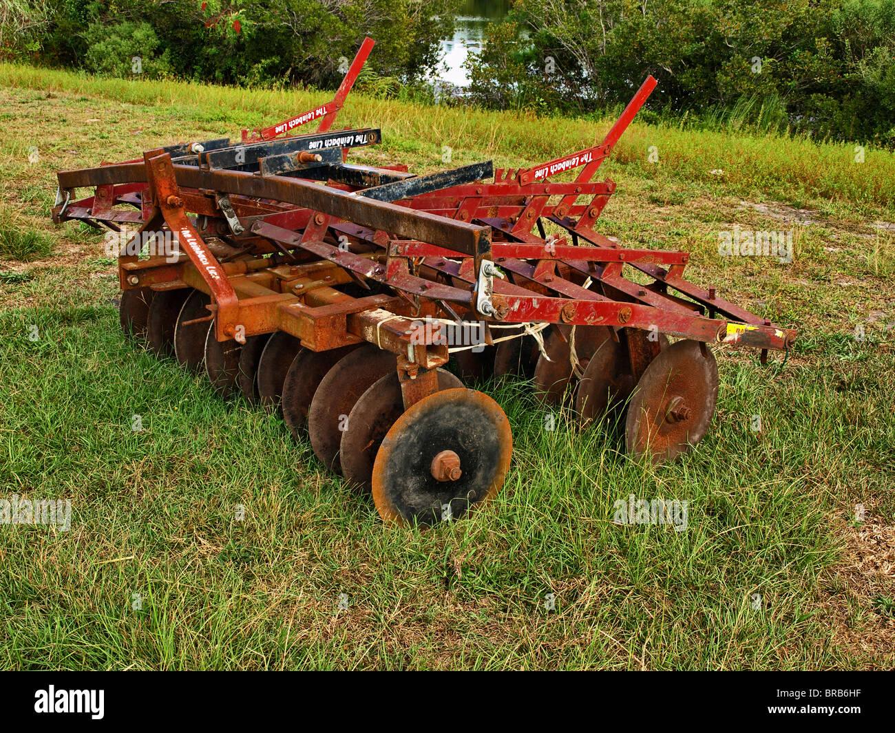 construction heavy equipment graders plow tractor disc roadwork mowing -  Stock Image