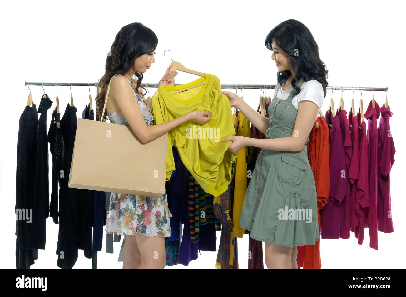 Women choosing clothes in a clothing store - Stock Image
