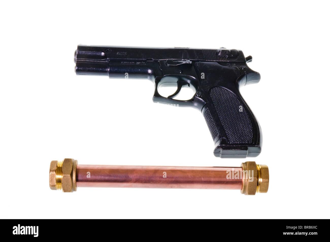Pipebomb and handgun - Stock Image