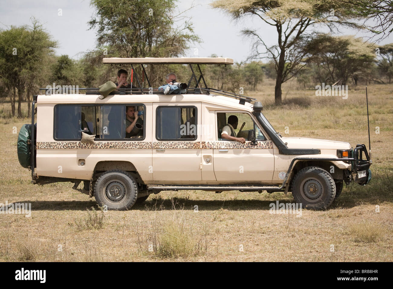 Toyota 4 x 4 Landcruiser on a photographic safari in Tanzania, Africa Stock Photo