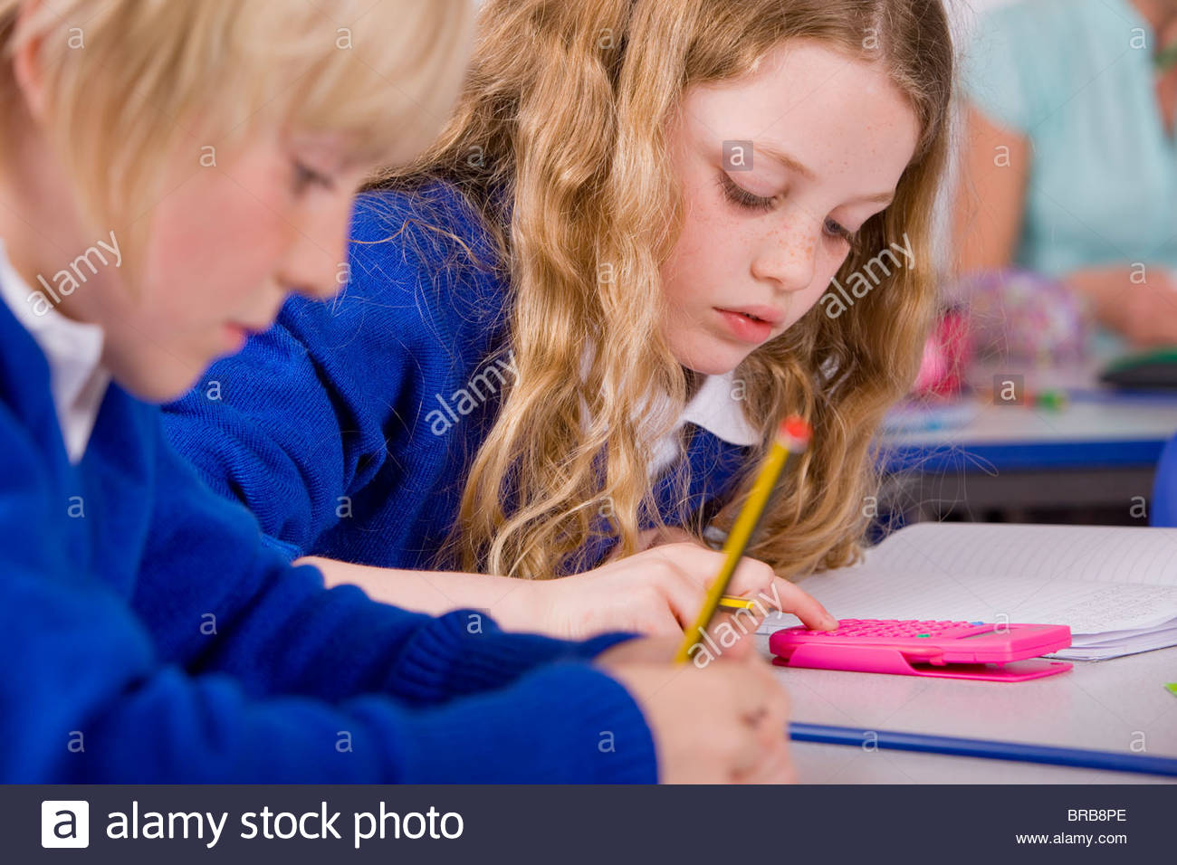 School children doing mathematics in classroom - Stock Image