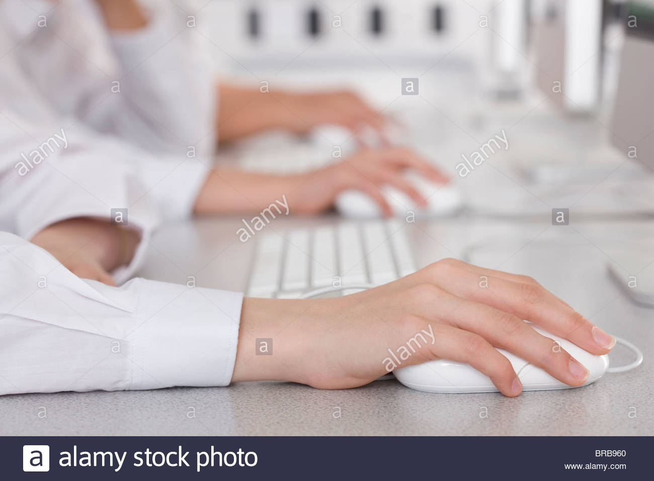 Students working on computers in school computer lab - Stock Image