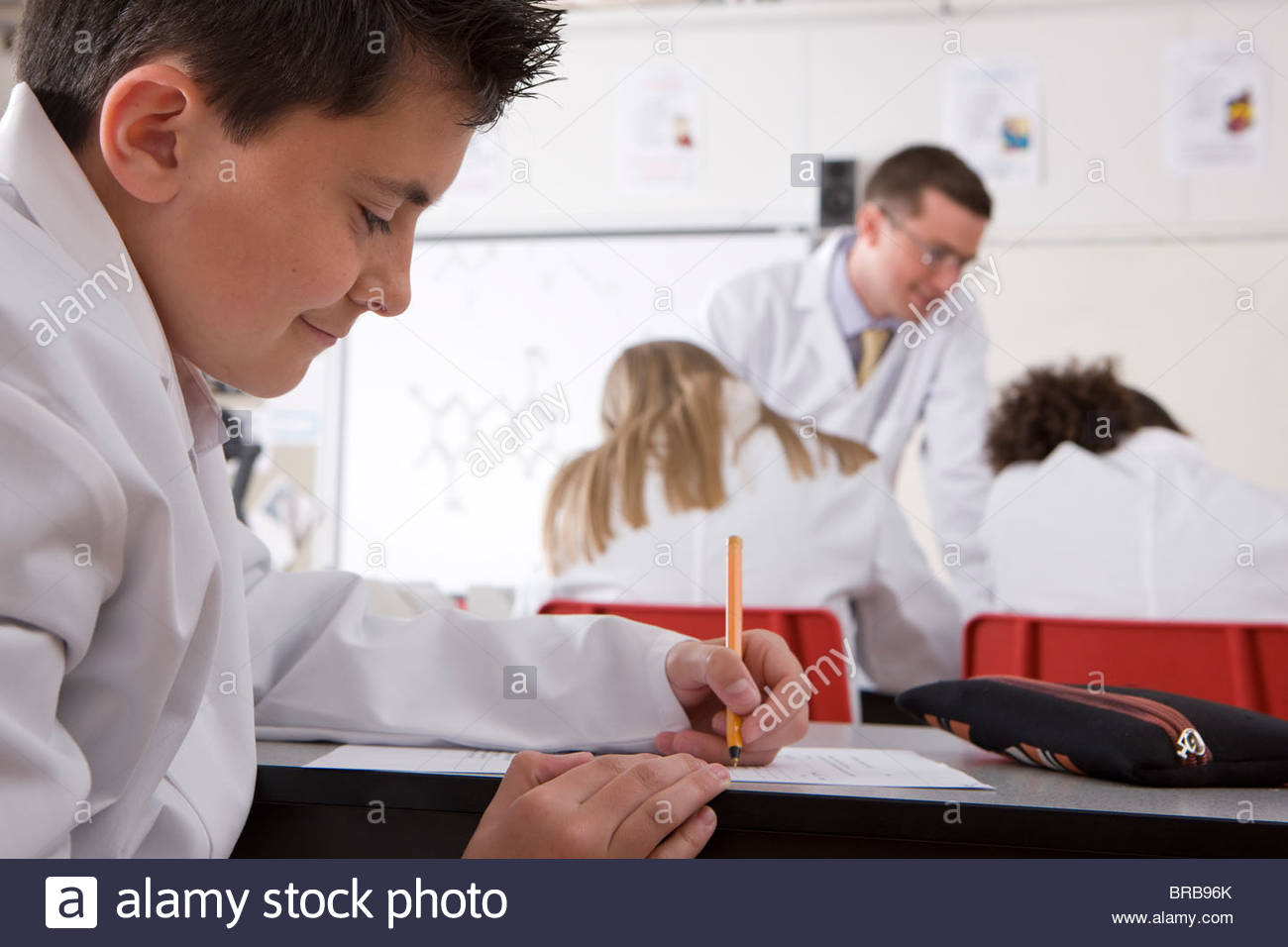 School boy taking test in school chemistry lab - Stock Image