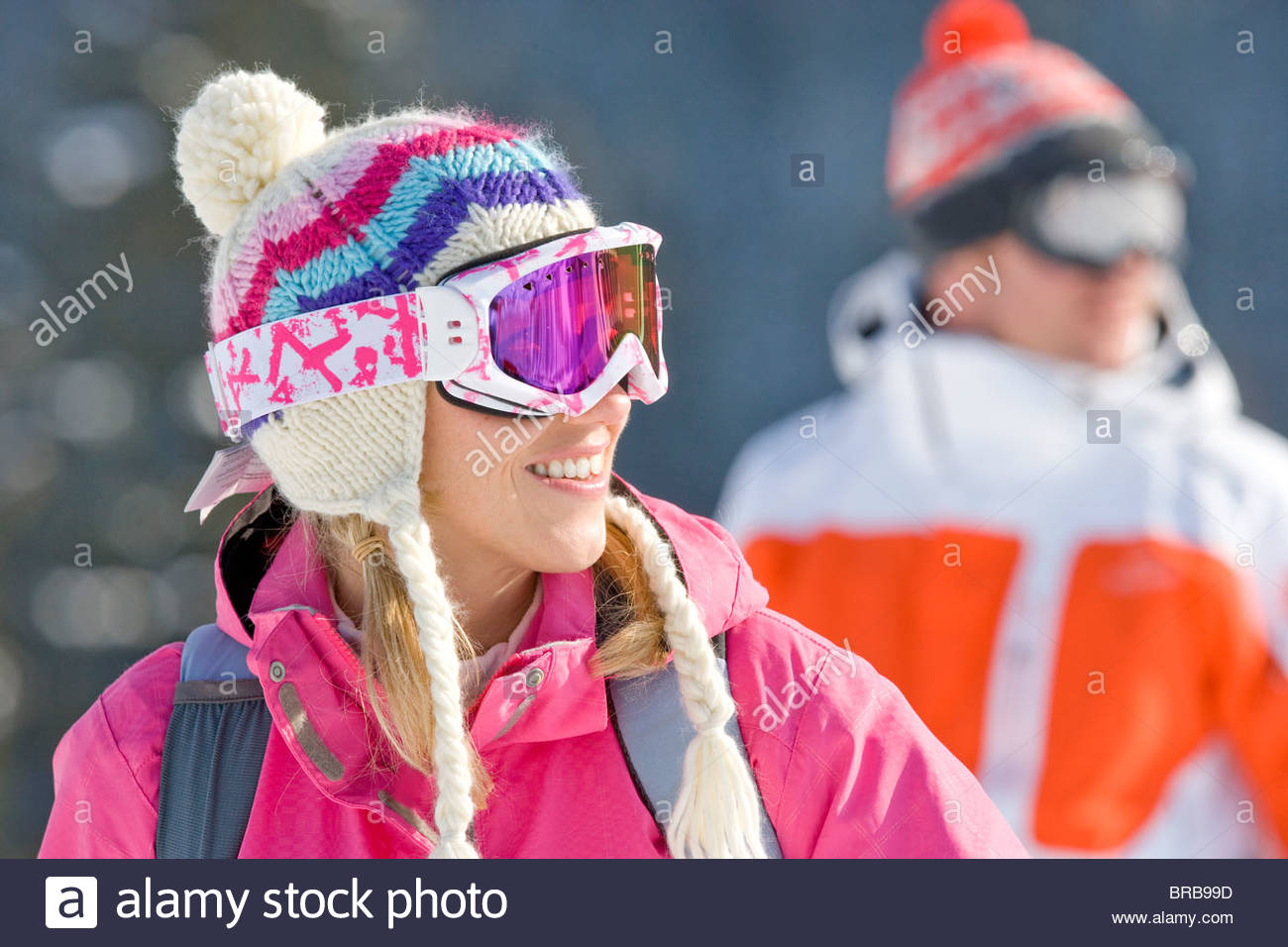 Couple in caps and goggles outdoors - Stock Image