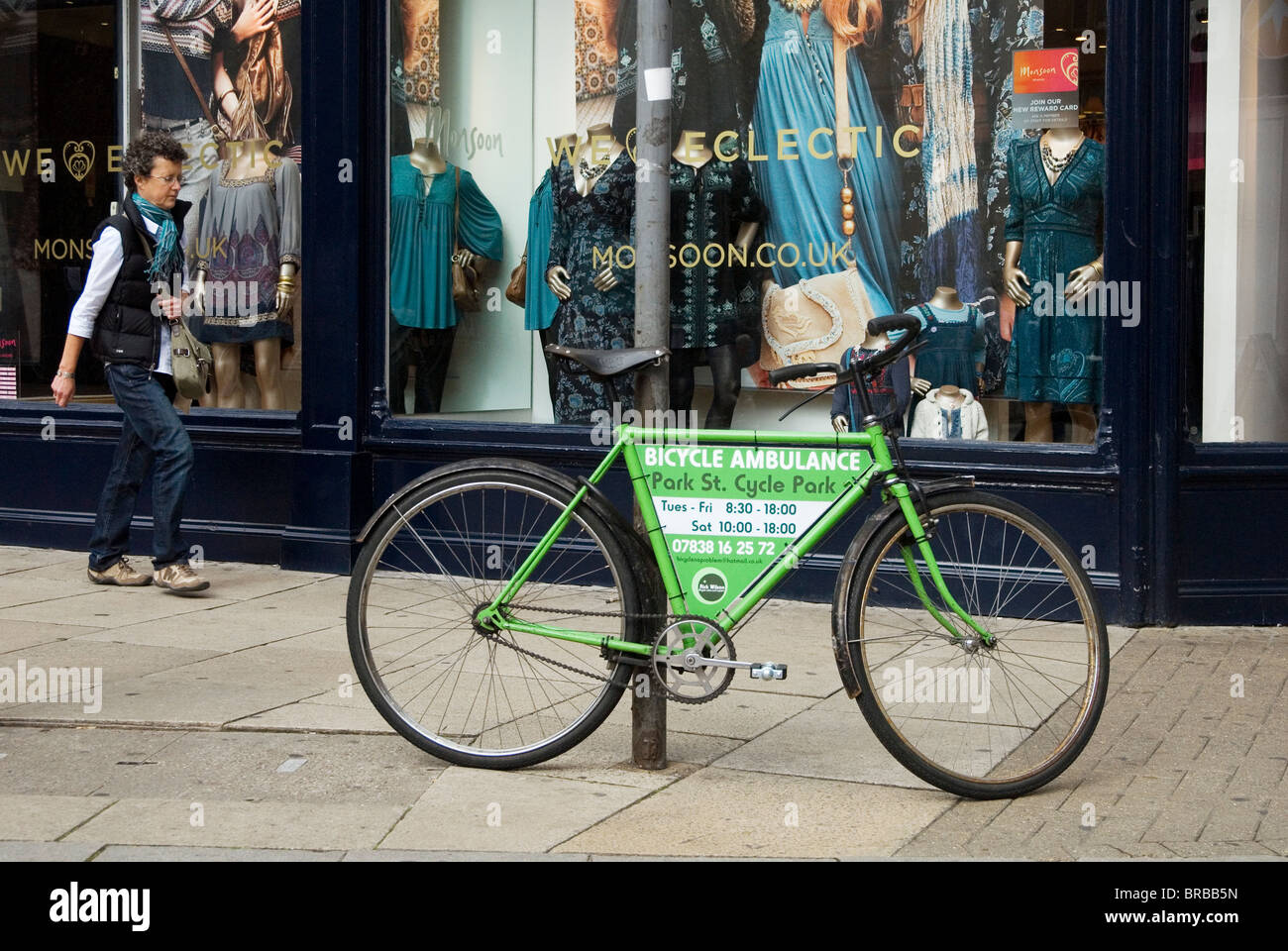 A bicycle being used to advertise the 'Bicycle Ambulance' cycle repair service parked on a busy shopping - Stock Image