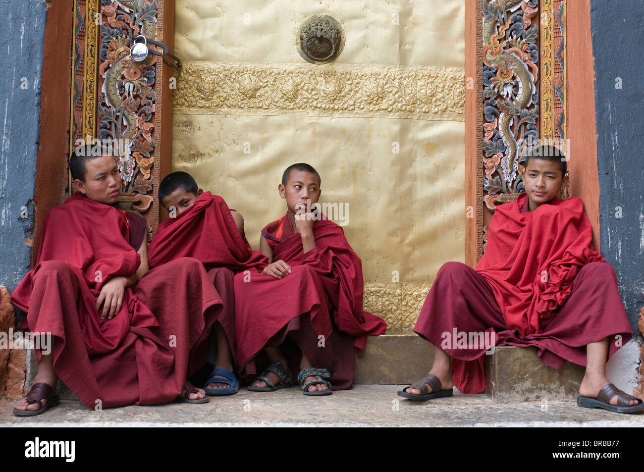 Young monks hanging out after praying, Punakha Tsong, an old fort, Bhutan - Stock Image