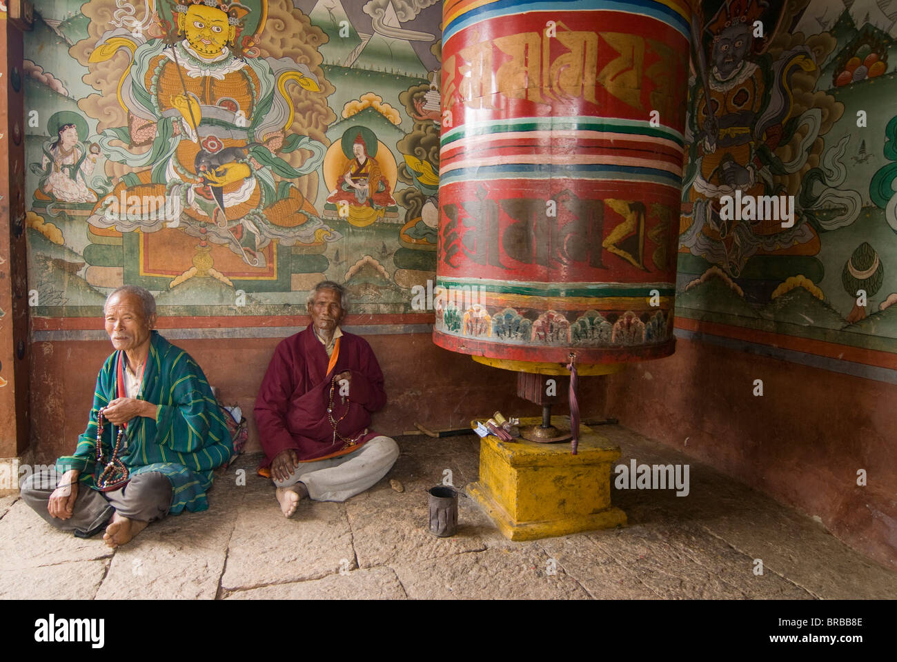 Old Buddhist monks, Chimi Lhakhang, Bhutan - Stock Image