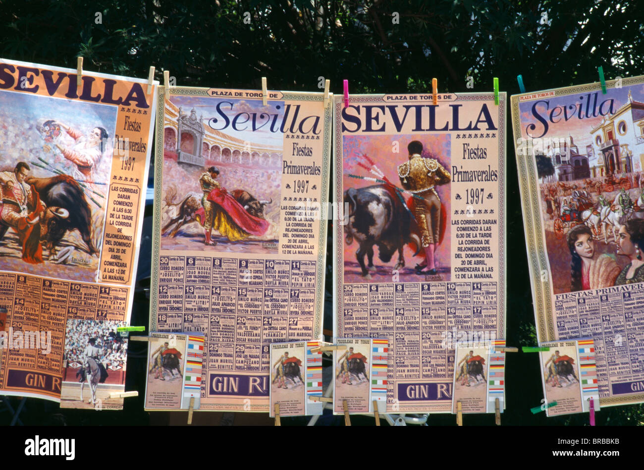 Spain Andalucia Seville Posters And Tickets For Bullfight Hanging On Line Outside Bullring In Arenal District during - Stock Image