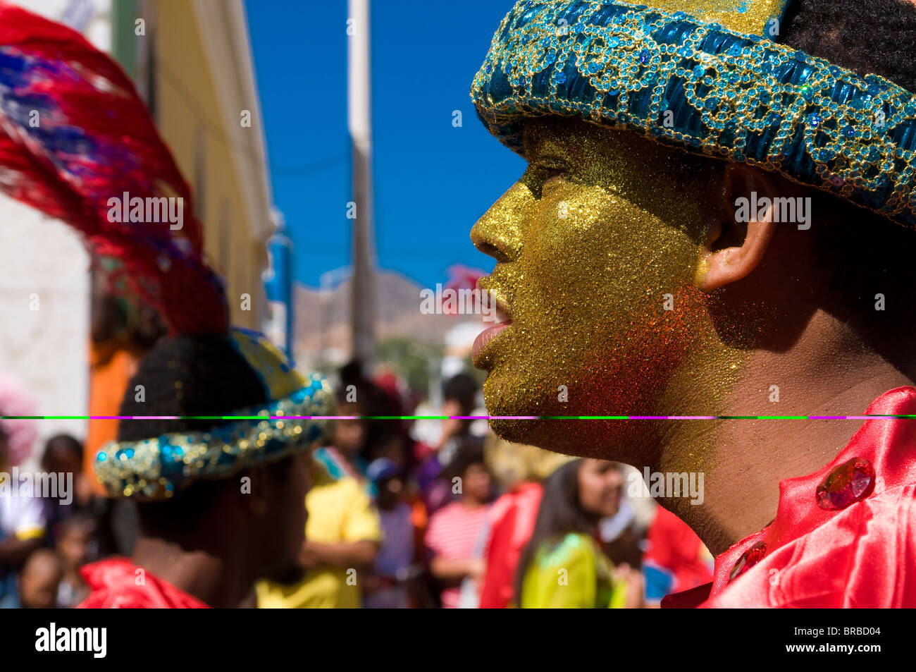 Portrait of young man with cap and coloured face, Carnival, Mindelo, Sao Vicente, Cape Verde - Stock Image