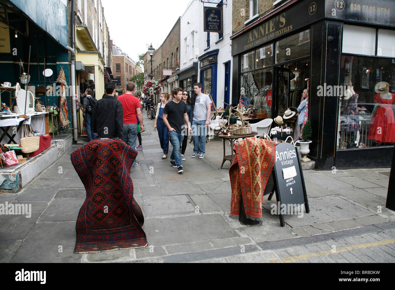Rugs for sale at Camden Passage antiques market, Islington, London, UK - Stock Image