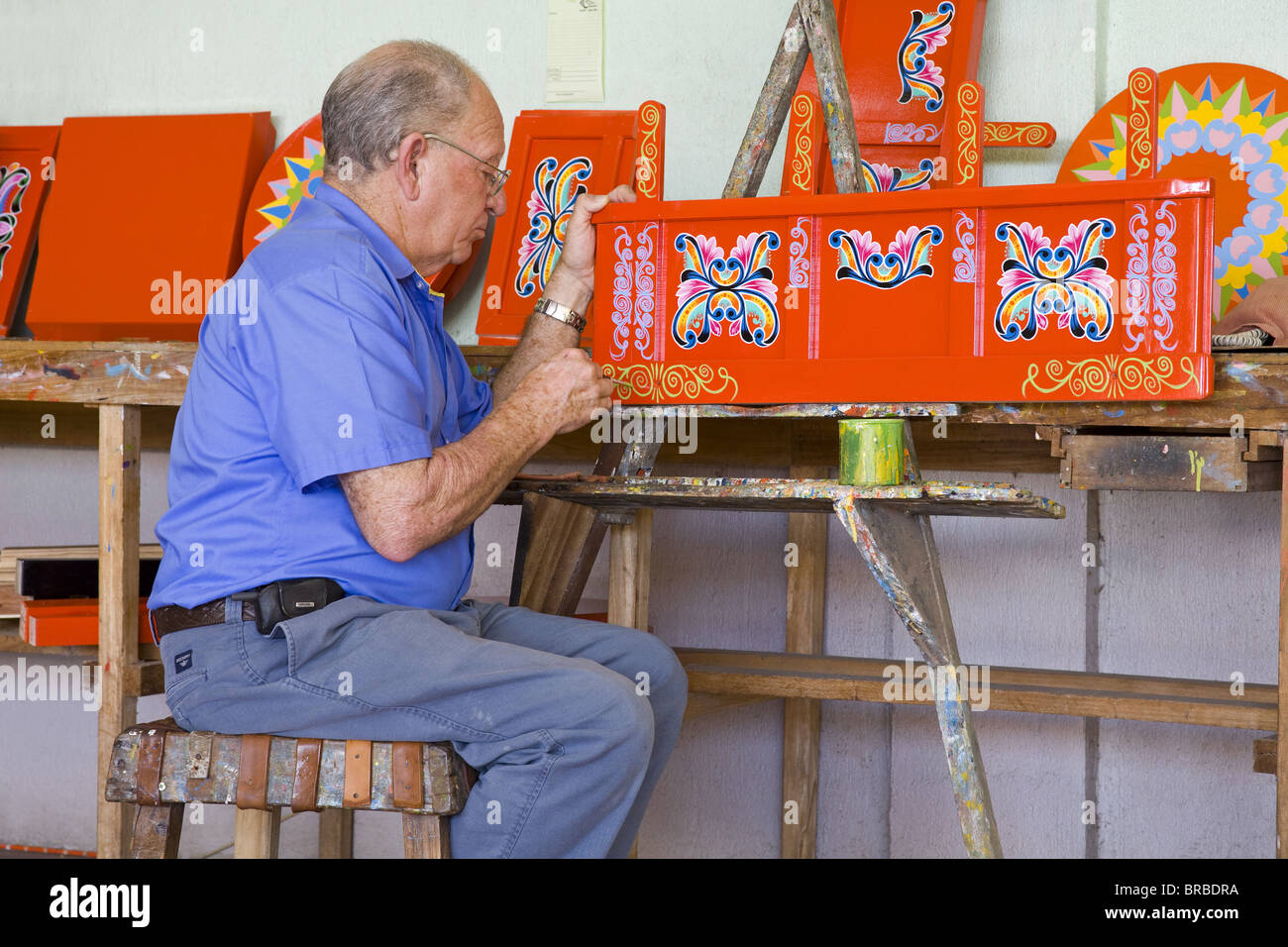 Artisan painting Ox-cart parts in Sarchi Village, Central Highlands, Costa Rica, Central America - Stock Image