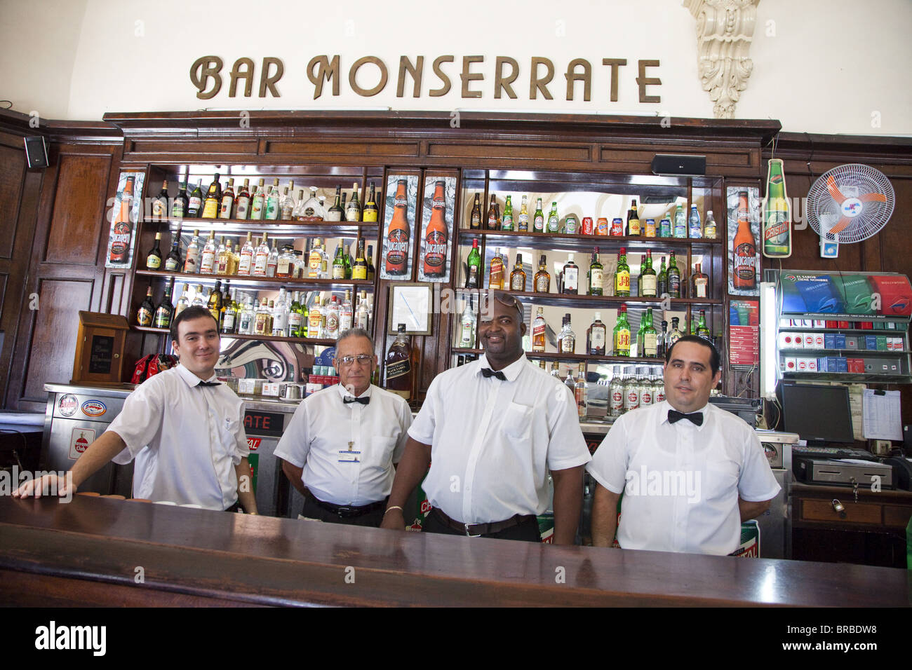 Bartenders and waiters at the Monserrate Bar in Central Havana, Havana, Cuba, West Indies, Central America - Stock Image