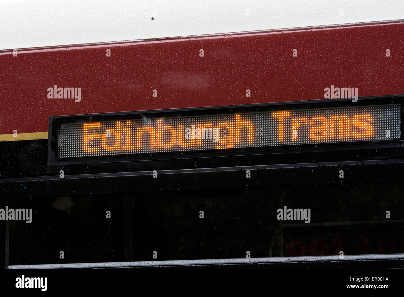 Illuminated sign on the side of a mock up Edinburgh tram. Delayed by financial problems. And traffic chaos. - Stock Image