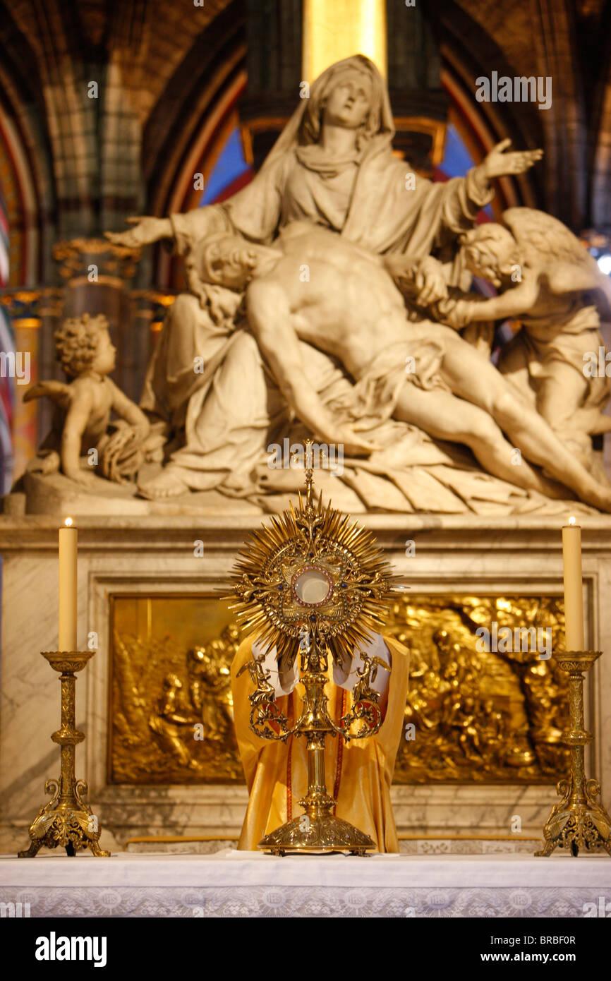 Eucharist adoration in Notre Dame de Paris cathedral, Paris, France - Stock Image