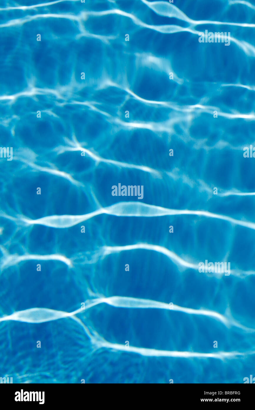 Light reflections in a swimming pool - Stock Image