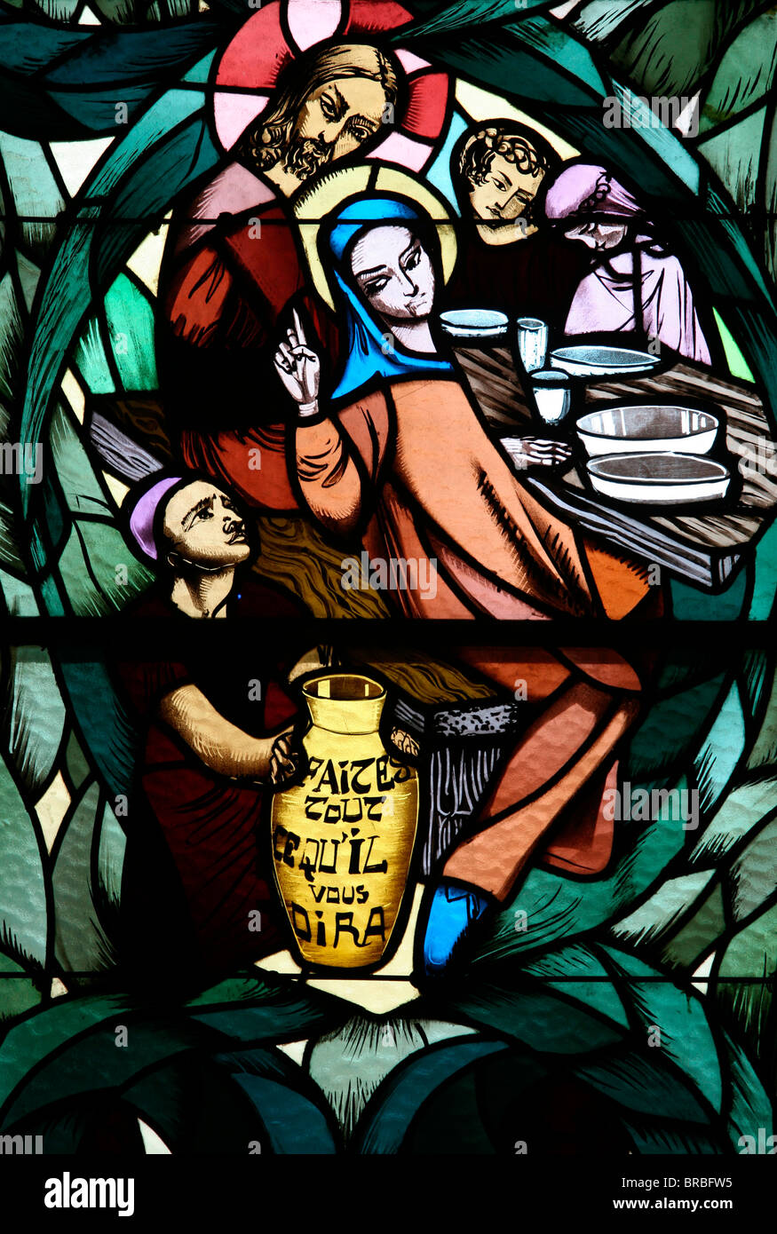 Stained glass window of the Cana wedding feast, Saint-Joseph des Fins church, Annecy, Haute Savoie, France Stock Photo