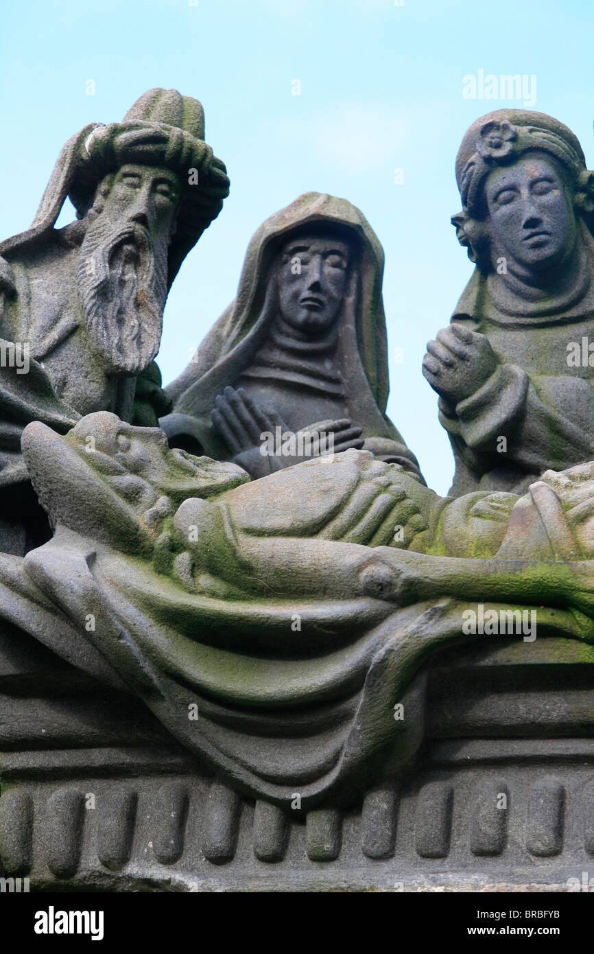 Entombment, a scene from the Life of Jesus on the Guimiliau calvary, Guimiliau, Finistere, Brittany, France - Stock Image
