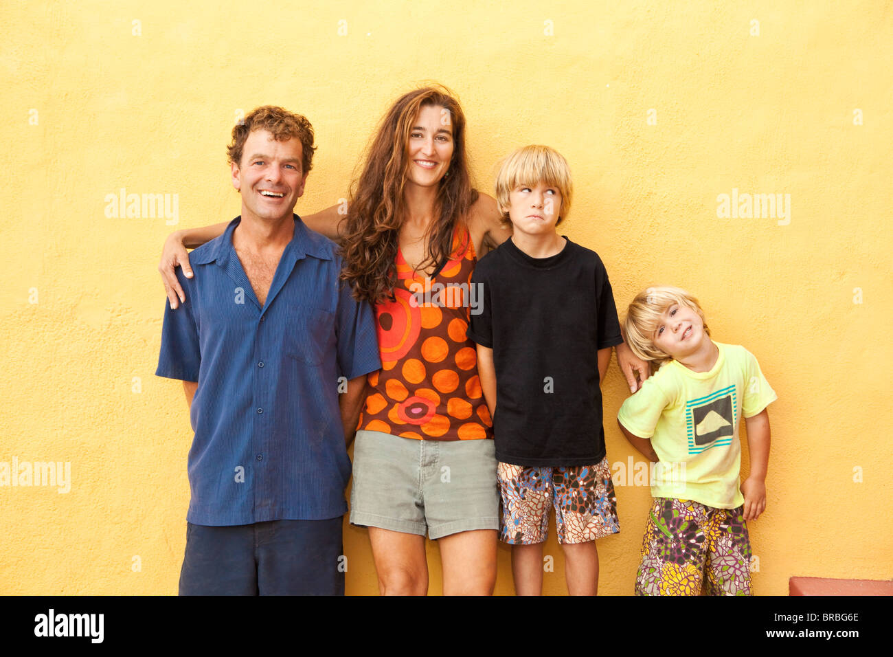 portrait of parents with young sons - Stock Image