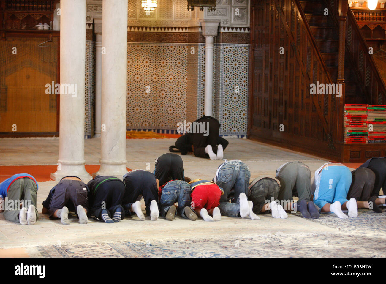 Young Muslims learning how to pray, Paris, France - Stock Image