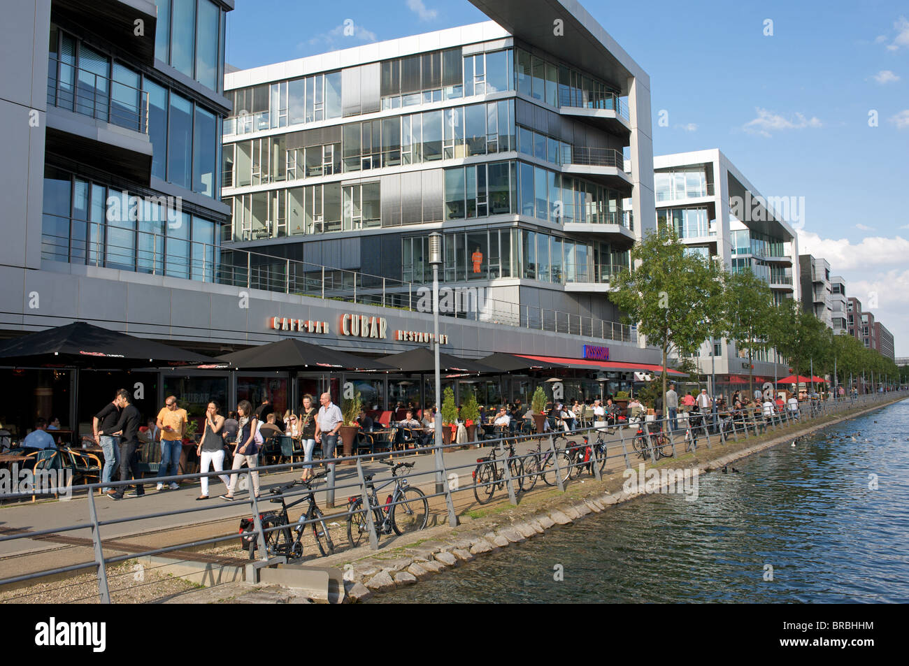 Waterfront cafes, restaurants and offices, Duisburg, North Rhine-Westphalia, Germany. - Stock Image