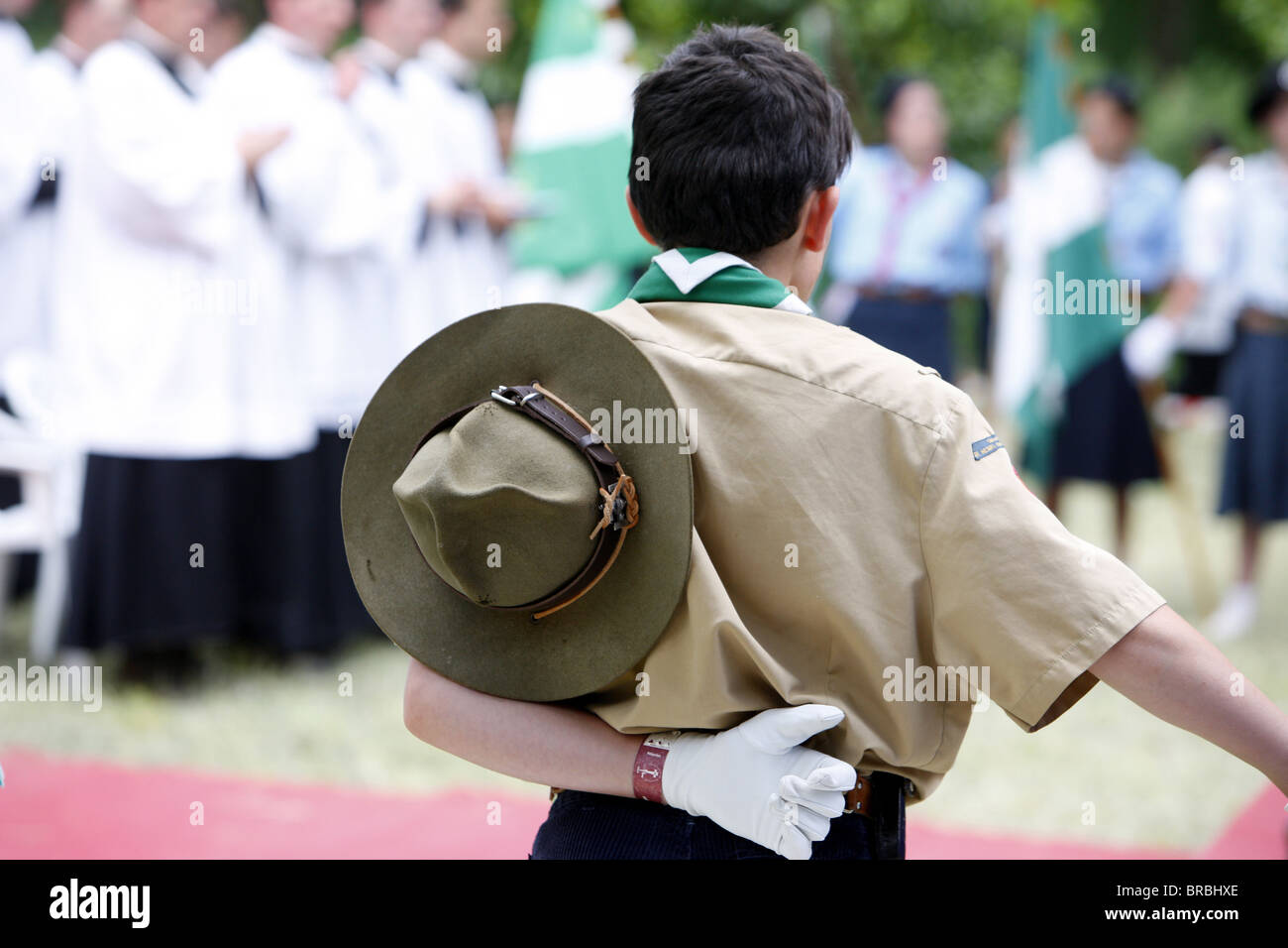 Boy scout at Catholic Mass, Villepreux, Yvelines, France - Stock Image